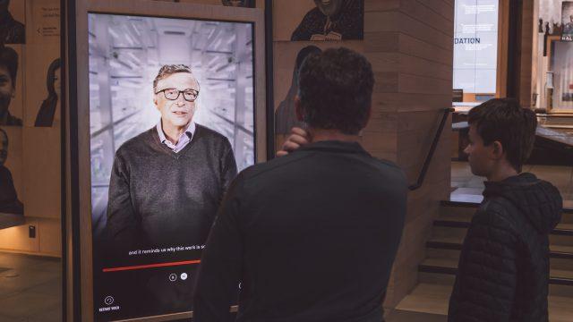 A visitor watches Bill Gates' interactive portrait